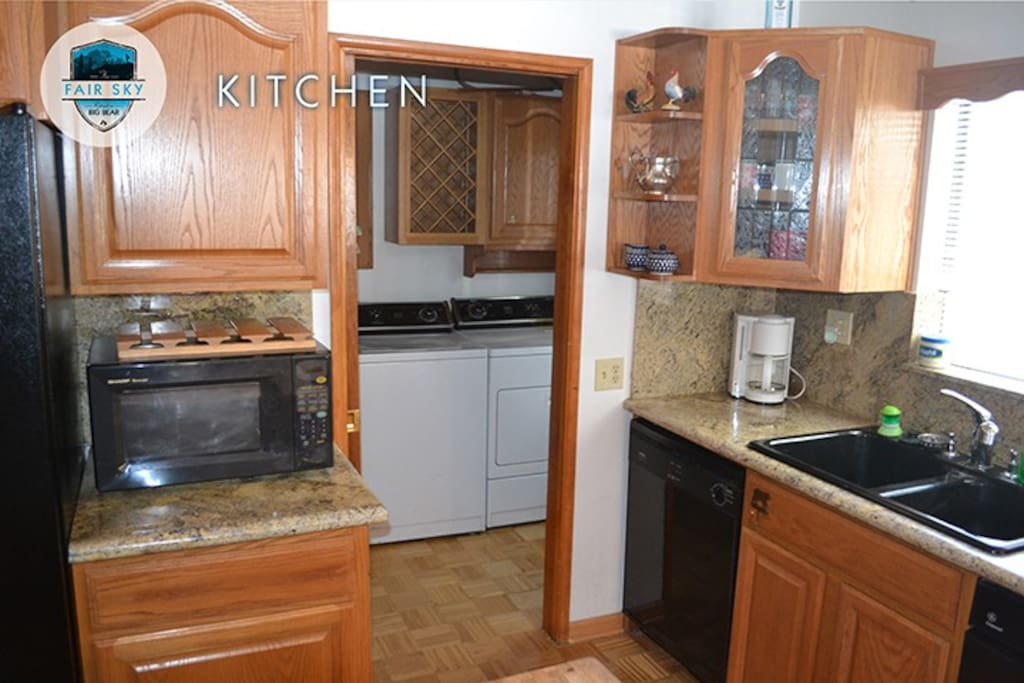 Microwave, coffee maker, dual sinks, dishwasher, trash compactor, laundry room with full size washer and dryer