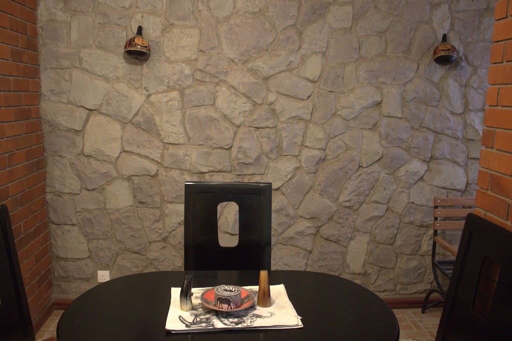 Stone wall that adds a homely feel to the apartment Nairobi Vacation rentals