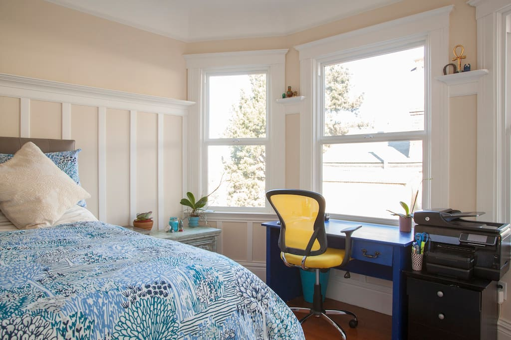 Master bedroom with views of Twin Peaks and Noe Valley neighborhood