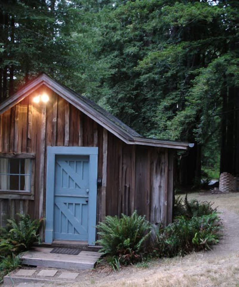 The cabin is nestled in 12 acres of redwoods about 100 feet from the main house and hot tub. It has it's own bathroom with shower and beautiful forest views.