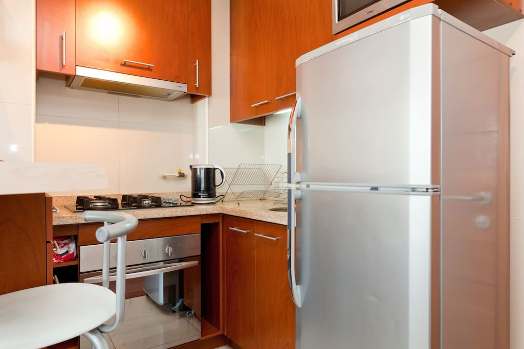 The kitchen includes a dishwasher, an electric oven, a kettle, a microwave and a fridge, of course
