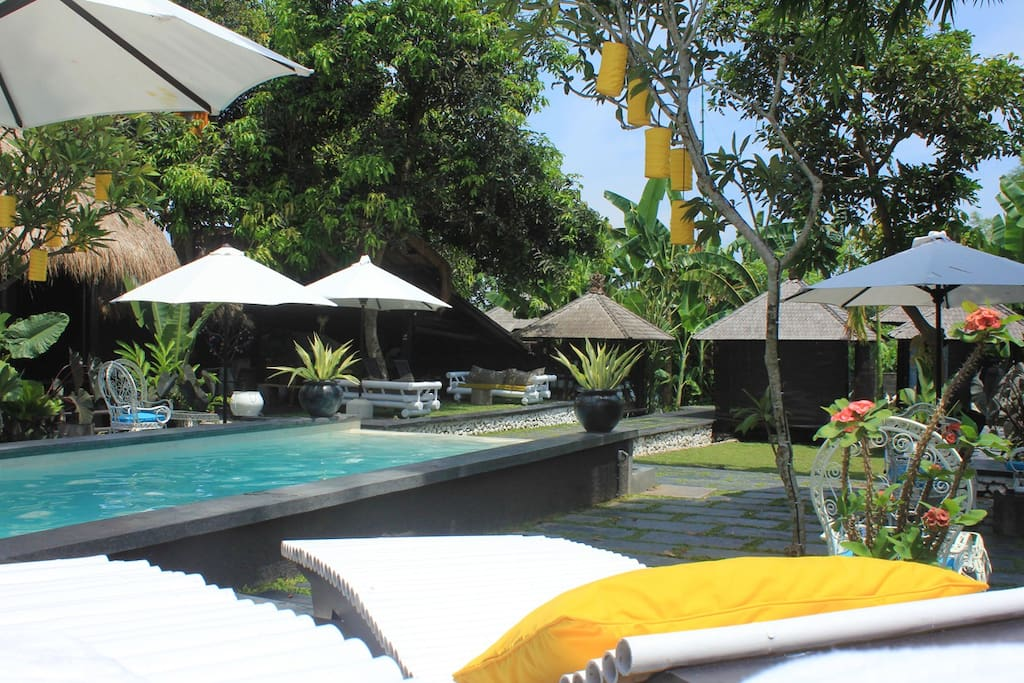 Relax on the sun loungers by the pool.