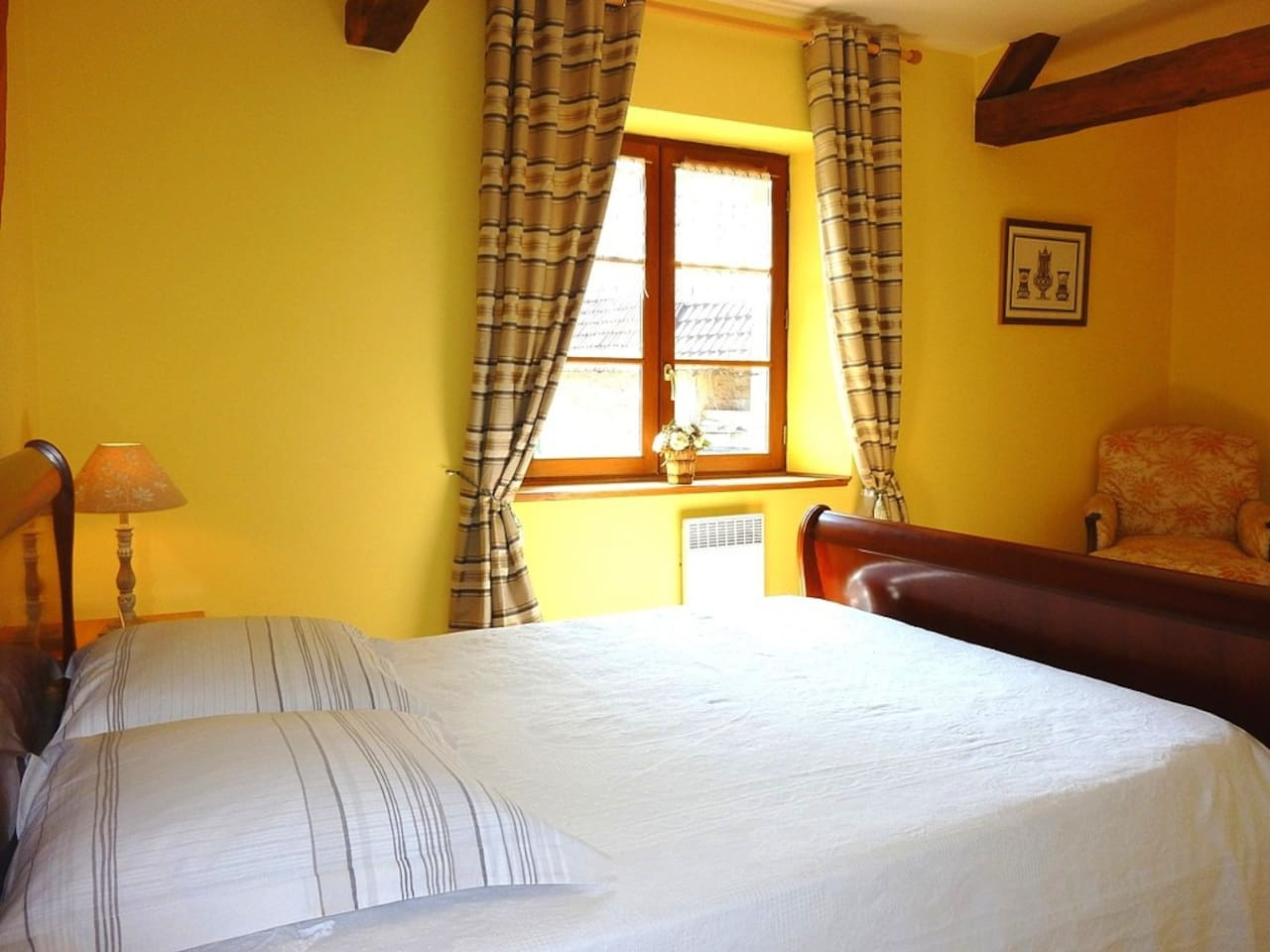 The sunny double bedroom with private bathroom has a view of the courtyard