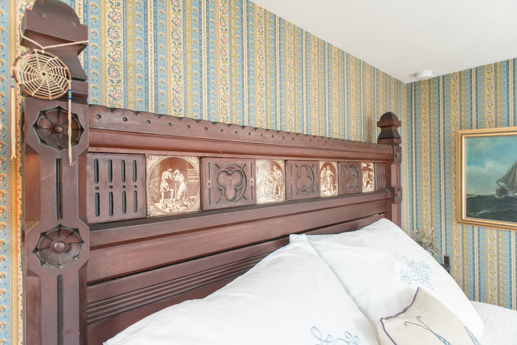 The tiles in the headboard represent specific scenes that you may be able to identify once you take a look at them....