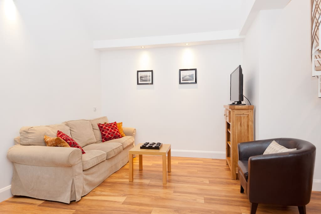 The apartment has wood floors throughout.