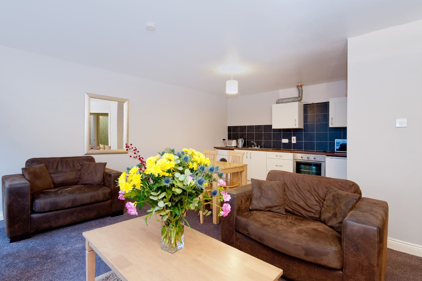 The spacious sitting room has plenty of opportunity for entertaining.