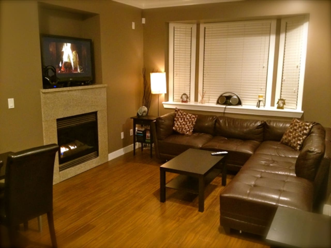 Cozy shared living room with fireplace, TV, and HD cable.
