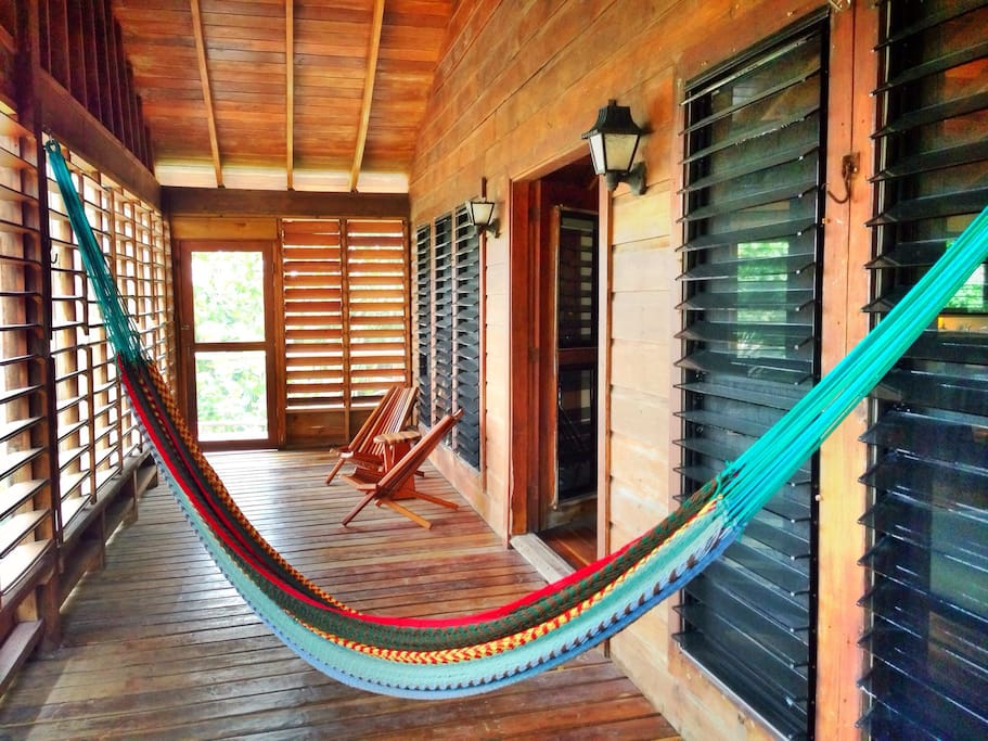 Great screened-in front porch with seating and an extra large hammock. Perfect for catching the evening breeze.