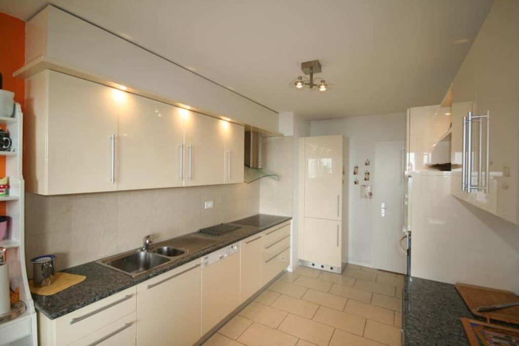 Large kitchen open to dinning and living room, fully equipped