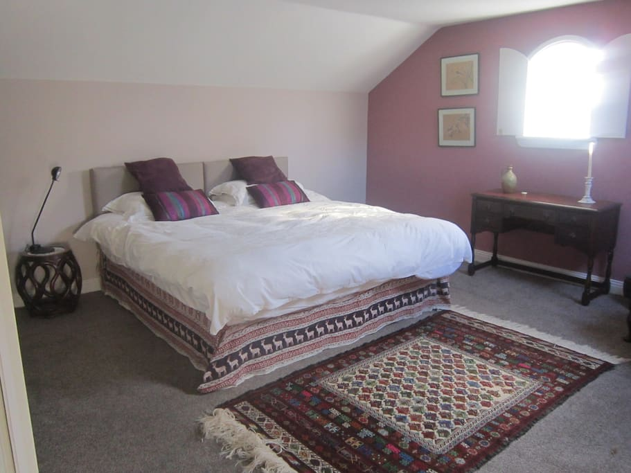 Spacious comfortable bedroom with tea and coffee making facilities