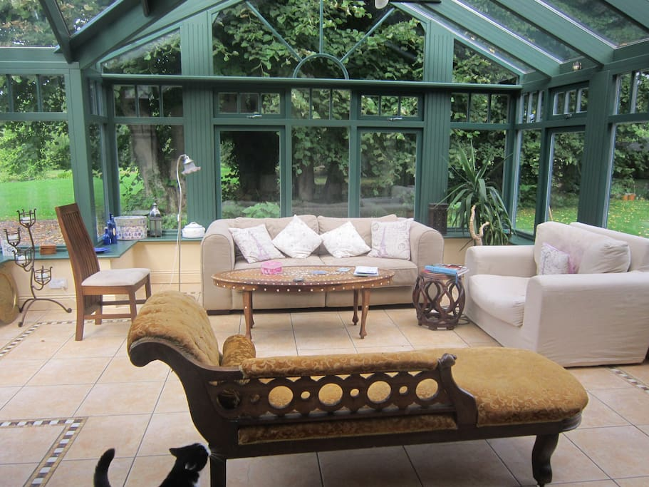 Sunny conservatory with view of gardens