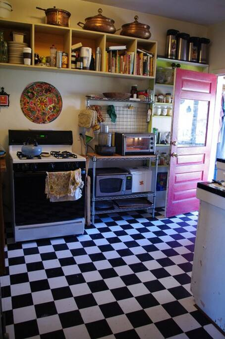 The kitchen (we love cooking, so are in here a lot). If you stay with us long enough you'll probably end up trying some of our food. :)