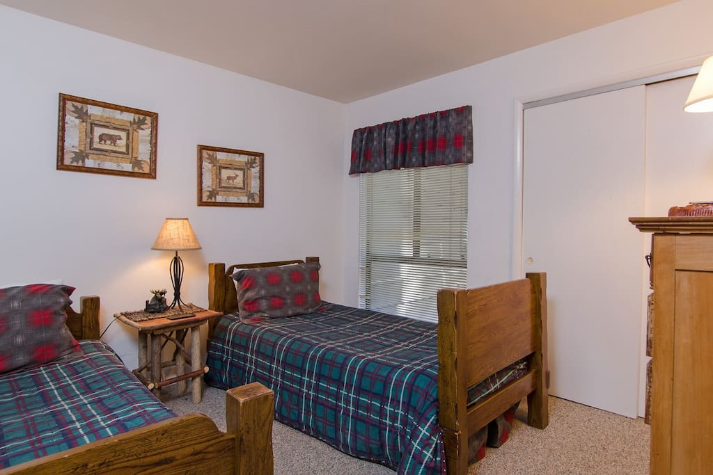 DOWNSTAIRS BEDROOM WITH TWO TWIN BEDS DECORATED WITH MOOSE DECOR