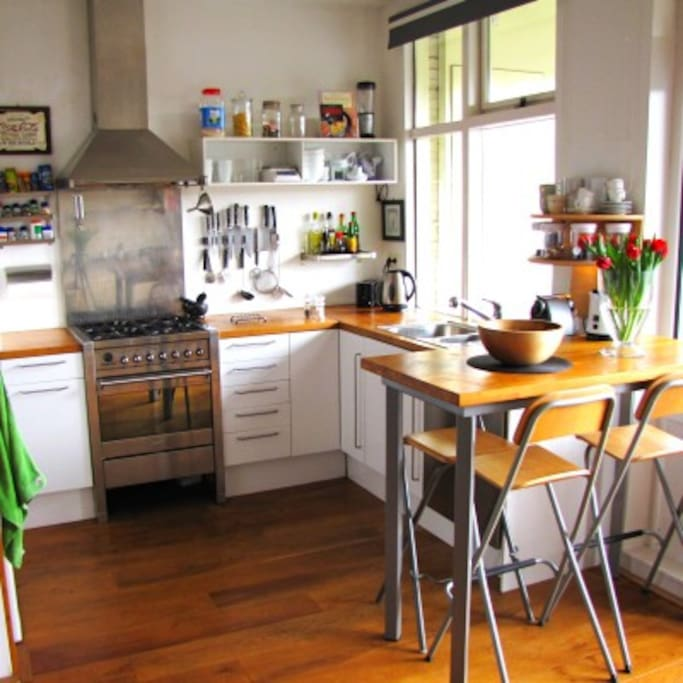 Fully equipped kitchen with dishwasher, microwave, fridge, Nespresso machine.