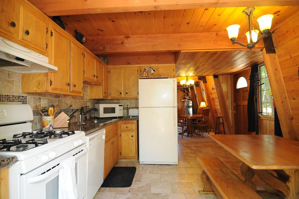 Eat in Kitchen with Granite counter and all Kitchenware provided.