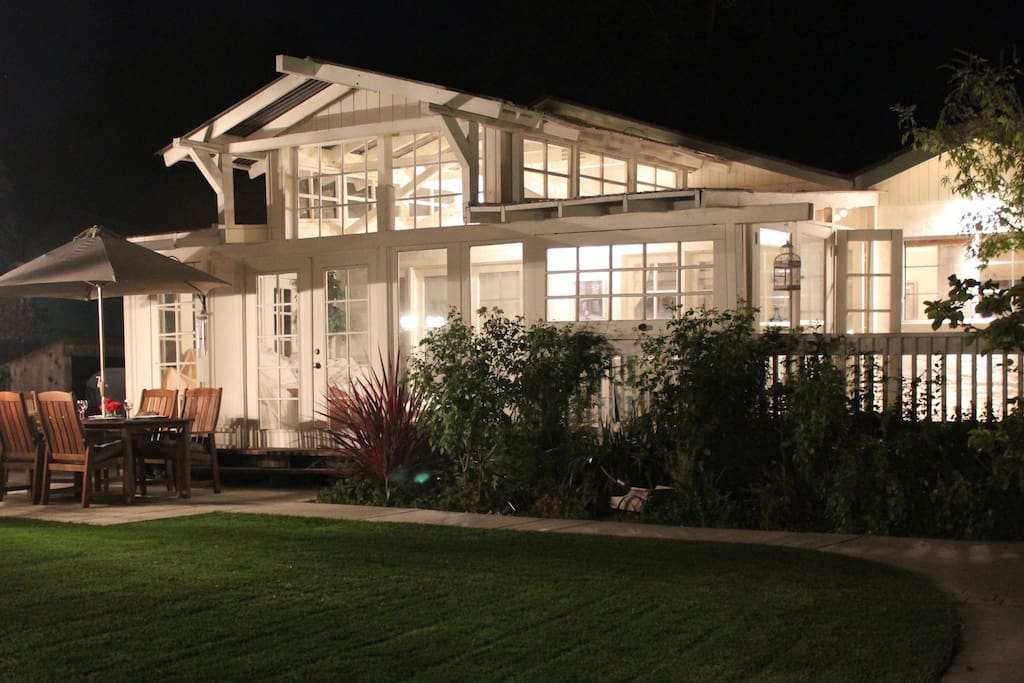 A nighttime view of the sunroom