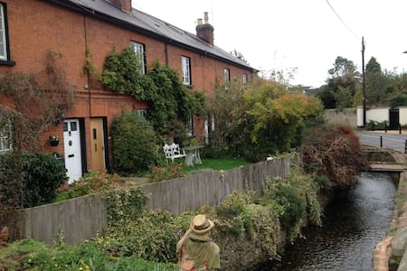 Terraced red brick village cottage. - East Budleigh