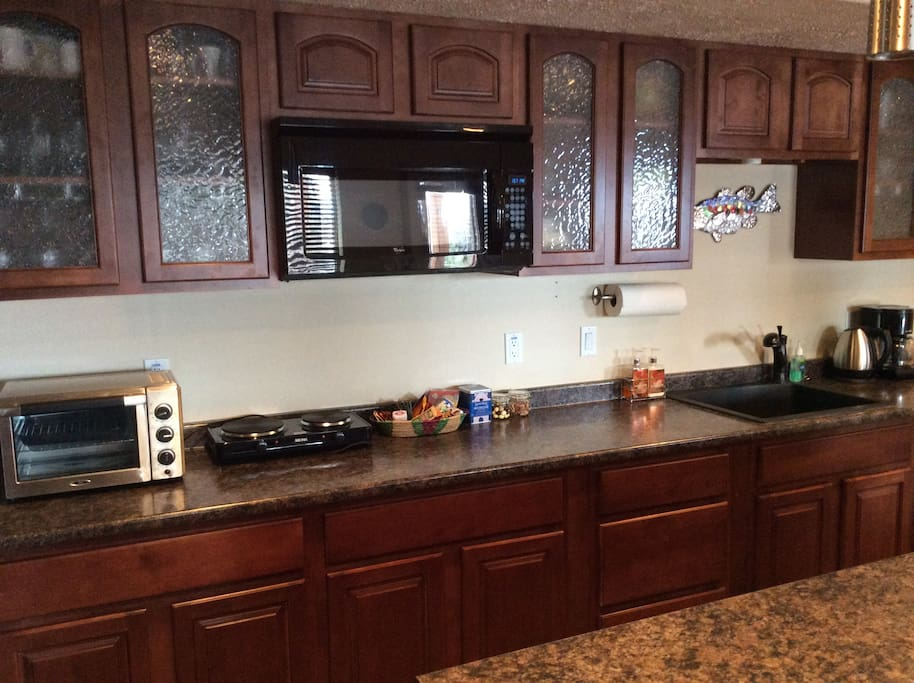 Kitchenette with coffee, toaster oven, hot plate and more