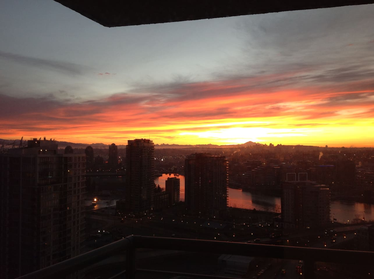Stunning sunrise reflecting in the waters of False creek - the view from every room!