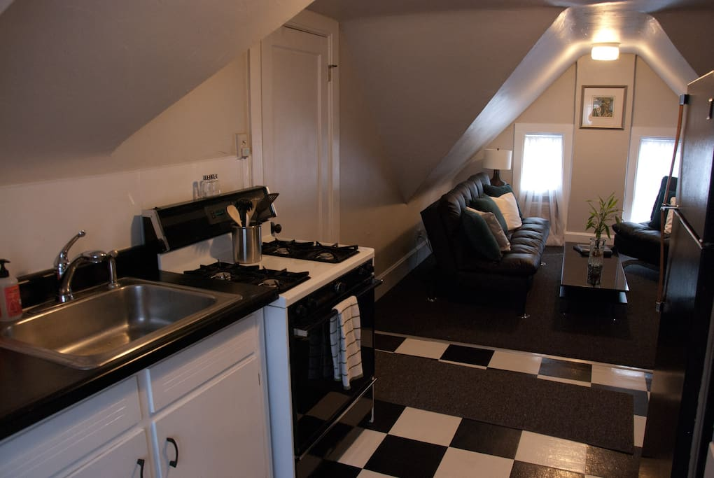Small Kitchen with full size stove and fridge.