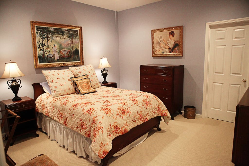 The bedroom now features a comfortable queen-sized bed and new furnishings.