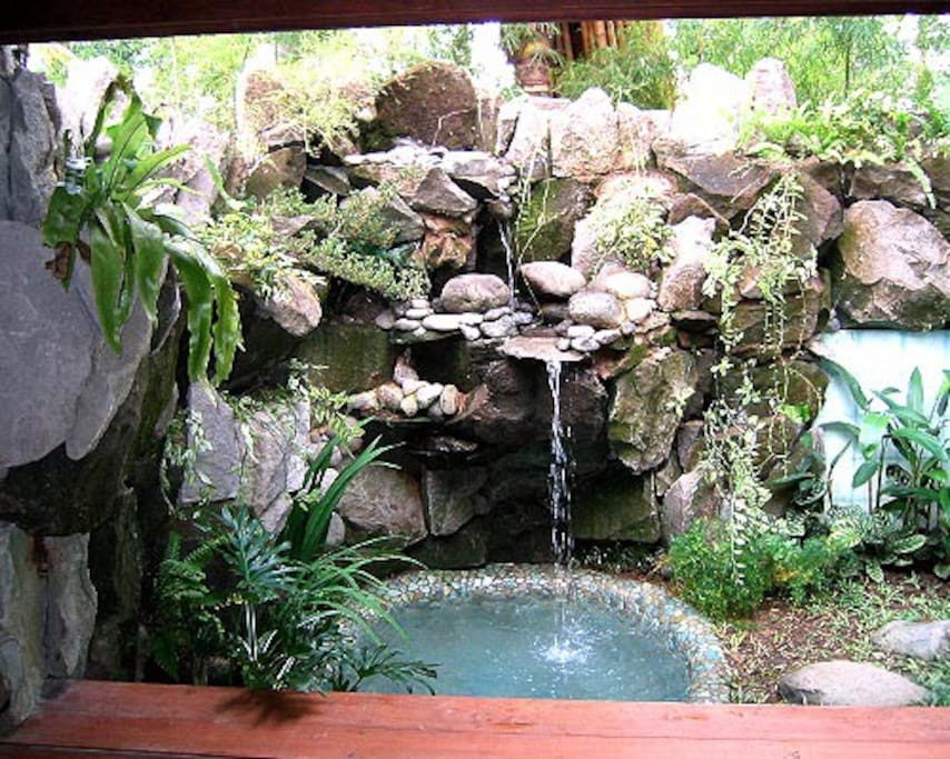 small water fall between meditation pavillion/guest bedroom and bathroom