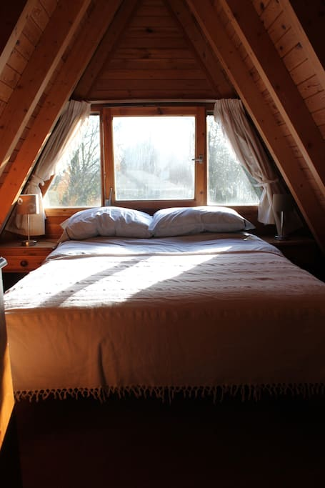 A double bed fits snugly in the sunny first floor bedroom.