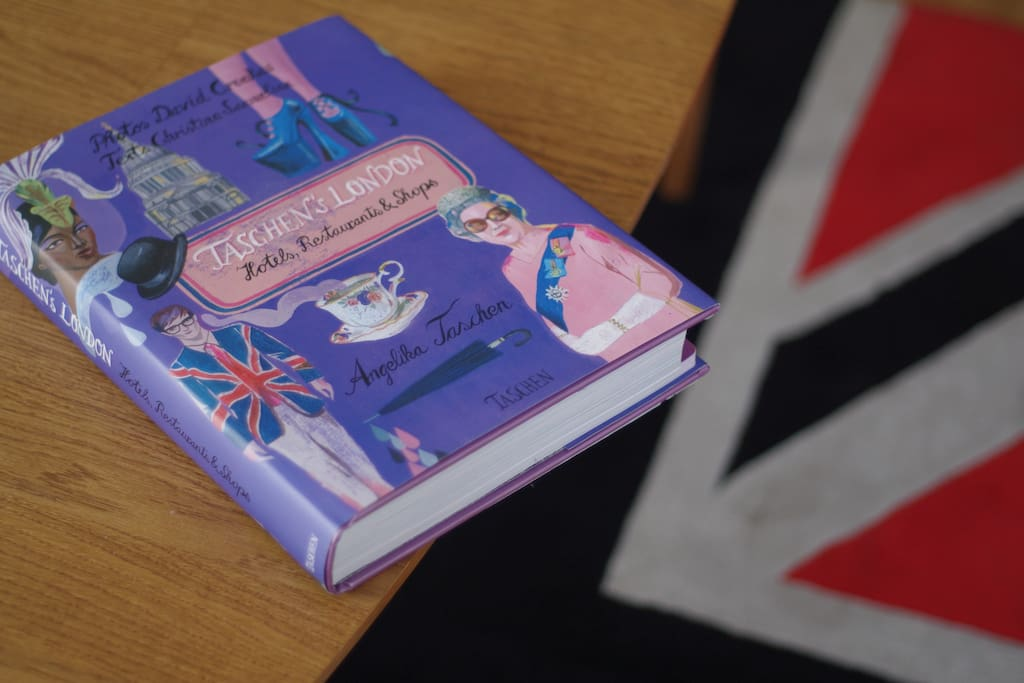 Book with suggestions of places to check out in London + other maps and guides inside the book