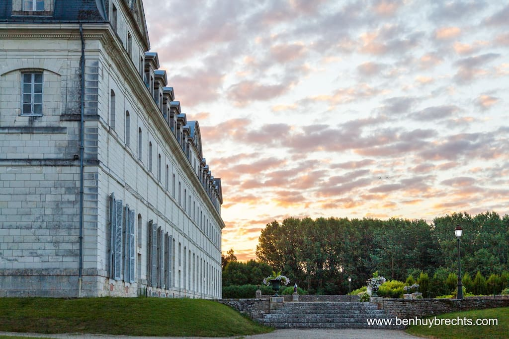 The abbey at sunset opposite Maison Clergeau