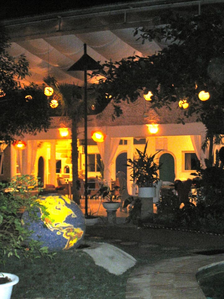 Looking at the outdoor area from the beautifully lit garden at night