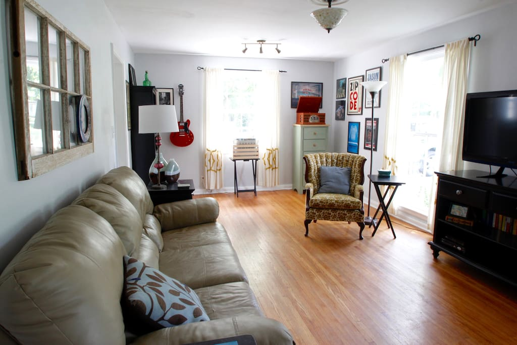 our living room is filled with sunlight, Nashville details, and is great for kicking back.  (literally, the sofa has recliners on either end!)