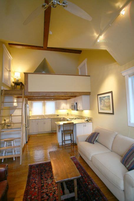 Living area, vaulted ceilings, loft and kitchen