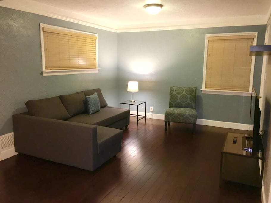 Livingroom with pullout full bed, 50 inch screen TV, Apple TV