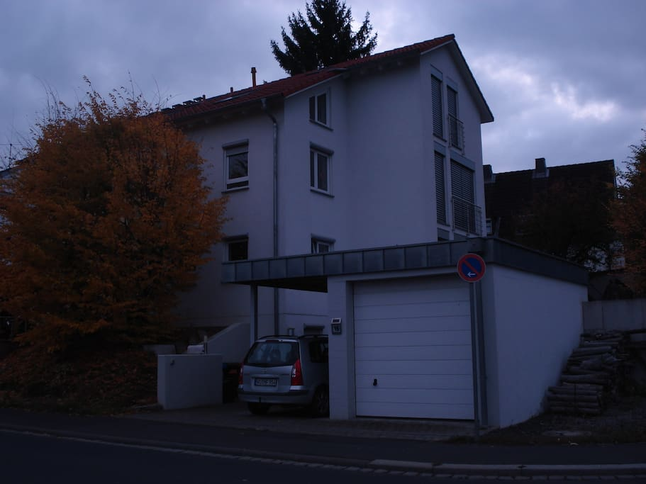 my house in Würzburg on Eisenbahnstraße, garage and car port used by me, but on the space to the right of the garage you can park your car off the street