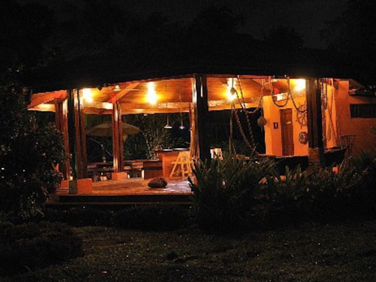 Gazeebo at night, in front of the house