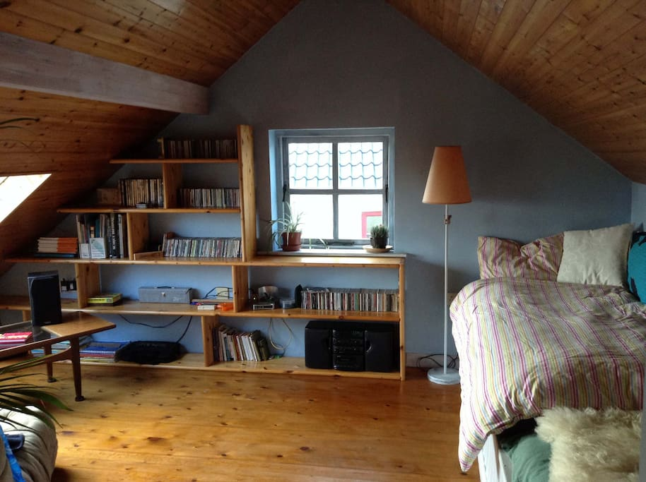 The loft. CD playing or plugin ipod facilities. Lovely place to chill on couch, cushions + can sleep 1 adult or 2 kids (very long futon type mattress)