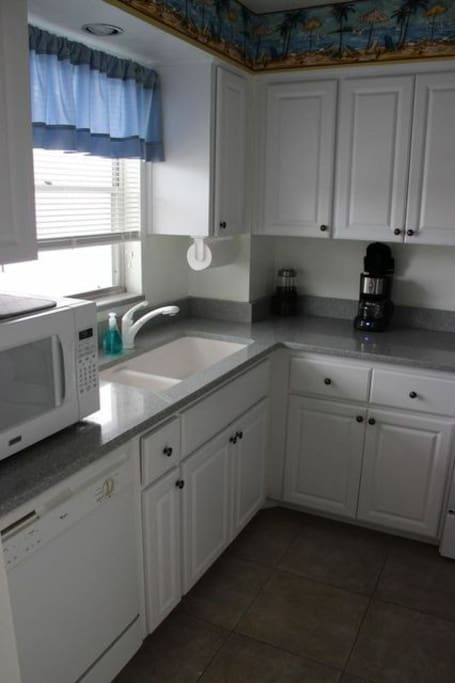 Well-equipped, updated kitchen.  Sea-foam quartz countertops, dishwasher, disposal, microwave.