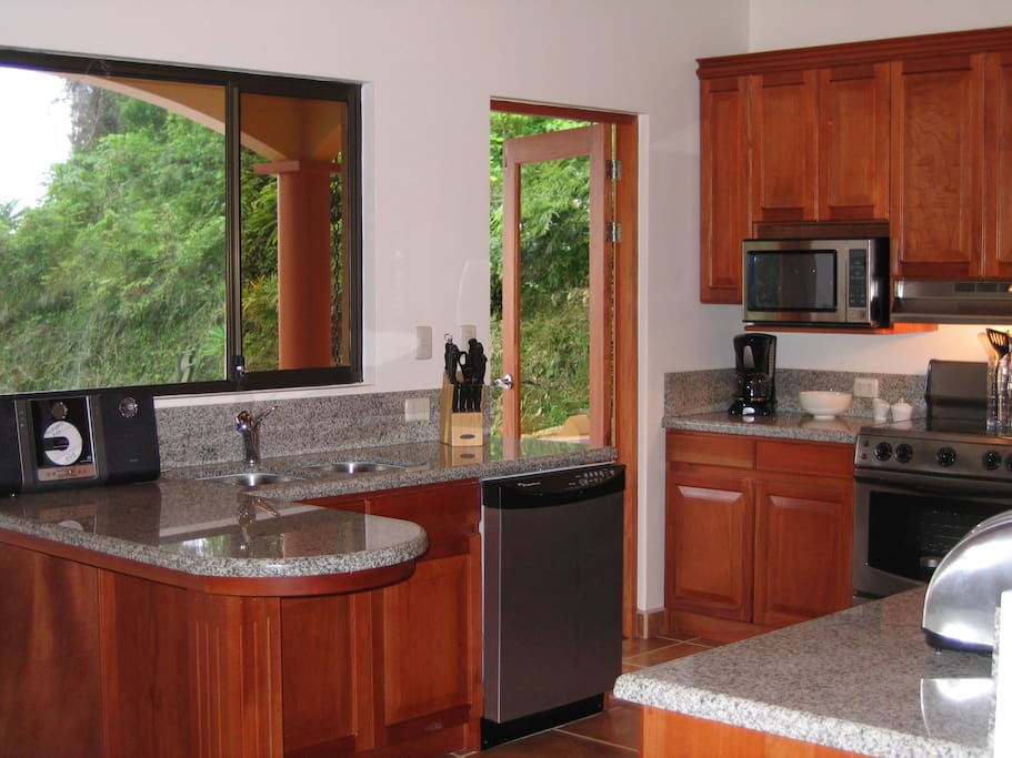 Gourmet kitchen with granite counters & stainless steel appliances