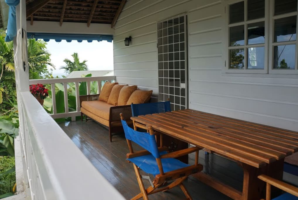 balcony with dining and sitting area