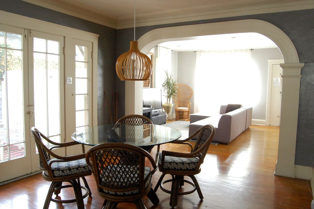 Dining room with round glass Z Gallerie table and modern accents. Easy access to outdoor patio