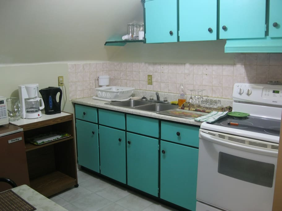 Kitchen, microwave, refrigerator, coffee maker, electric kettle, toaster