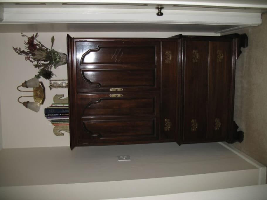 Armoire outside of bathroom for linens
