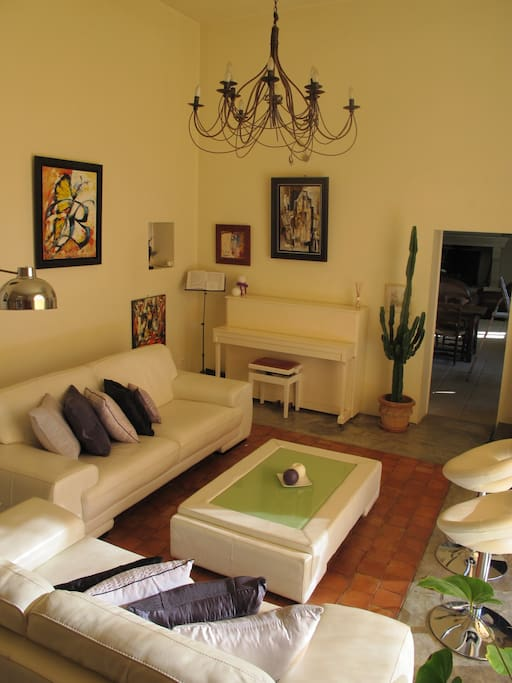 Same lounge area includes piano, large flat screen television...