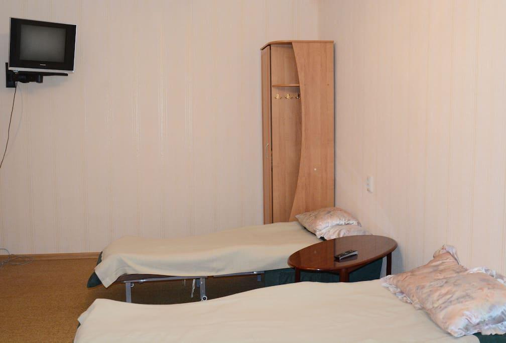 Спальня. Два кресла-кровати в разложенном виде. / Bedroom