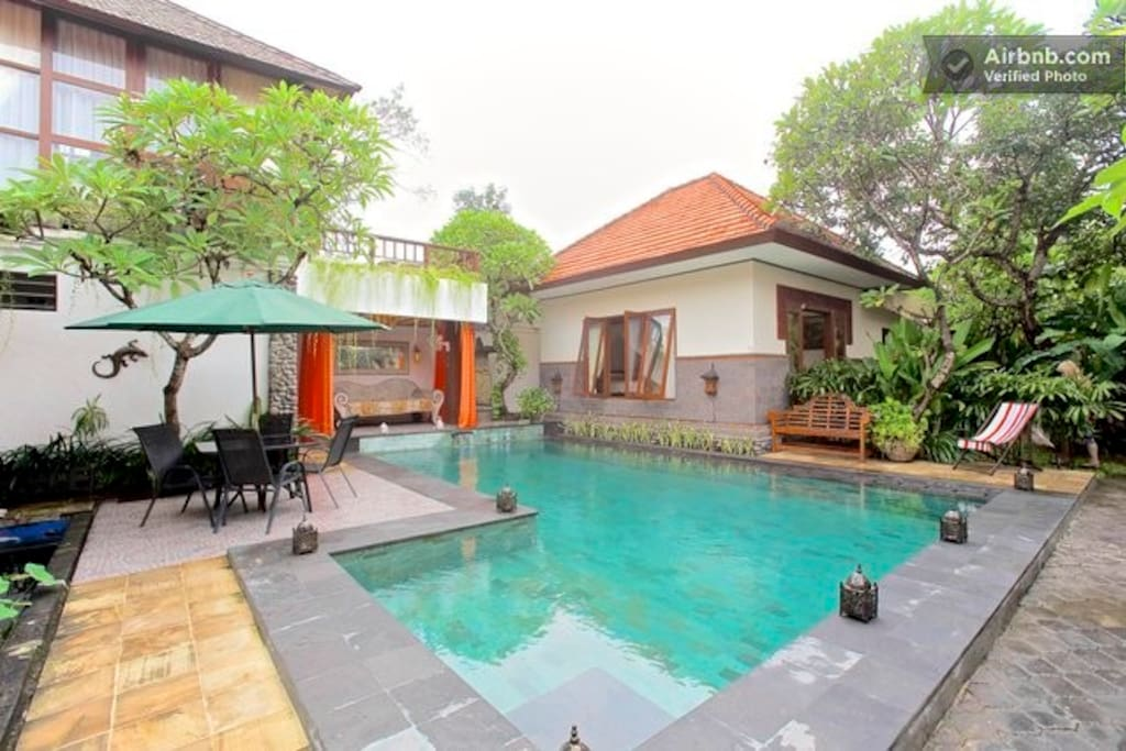 Villa room, shared pool and kitchen