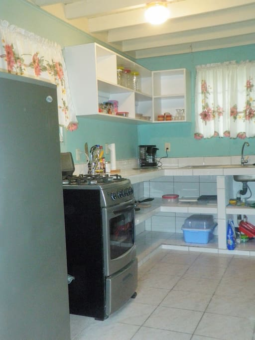 Fully equipped kitchen with fridge propane stove/oven.
