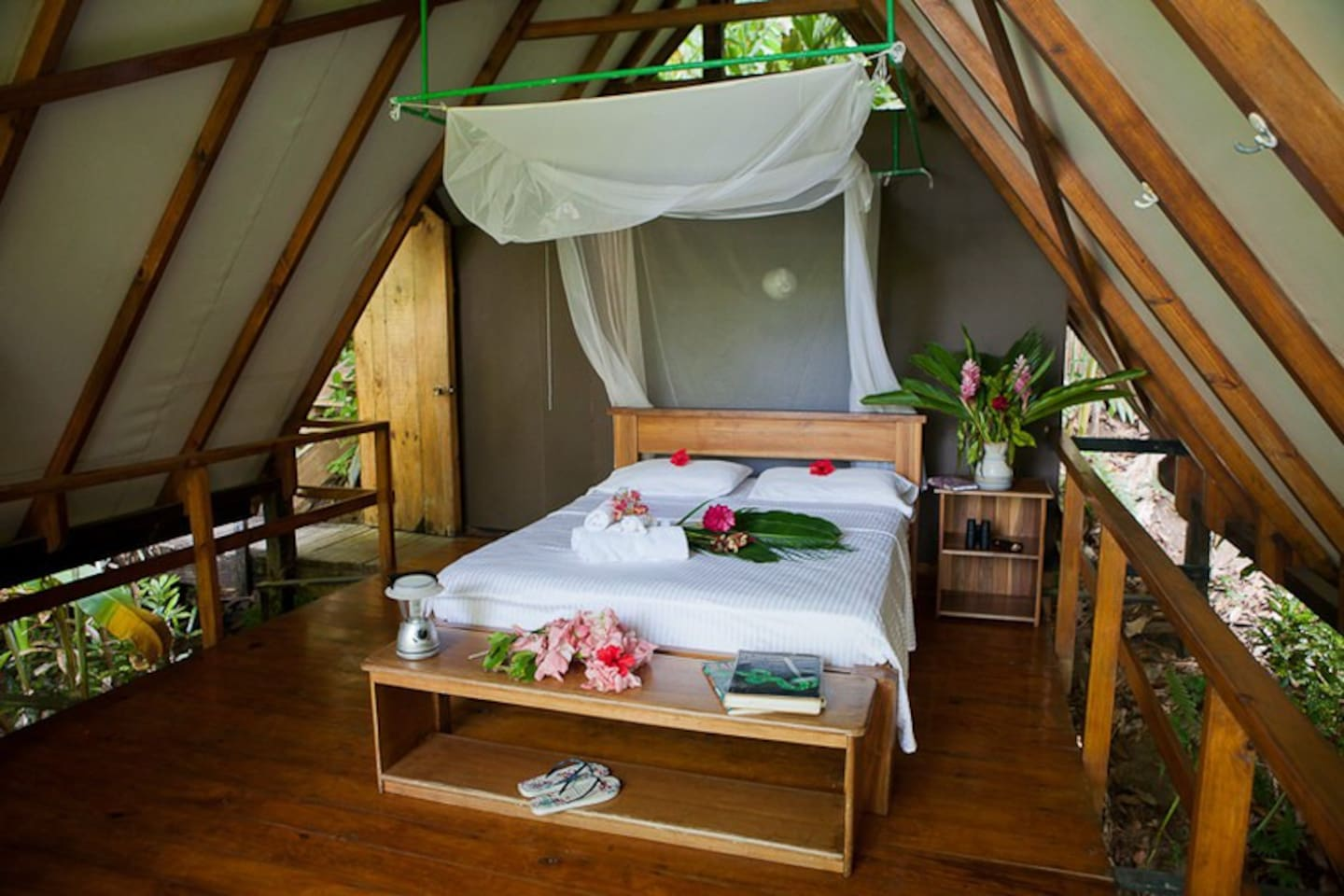 Queen sized bed with open views of the rainforest and Pacific Ocean.