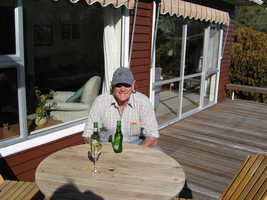 On the front deck at our house, wonderful place for drinking wine or a small beer