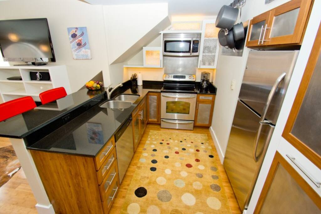 The kitchen has stainless steel appliances and granite countertops.