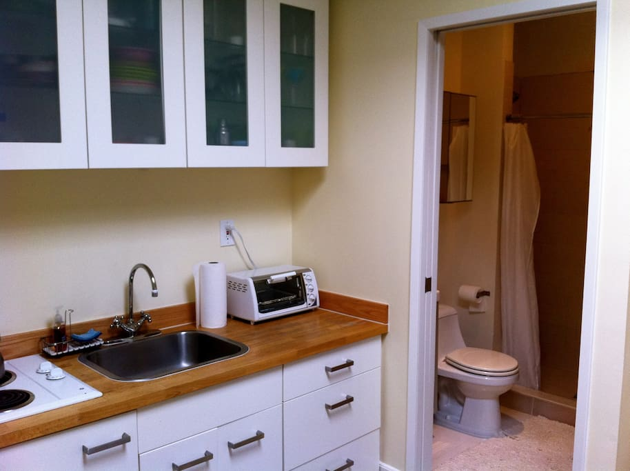 The bathroom makes the most out of a small space. It has a tile shower with hotel quality massage showerhead.